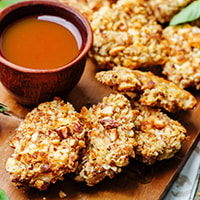 photo of almond-crusted pork with dipping sauce